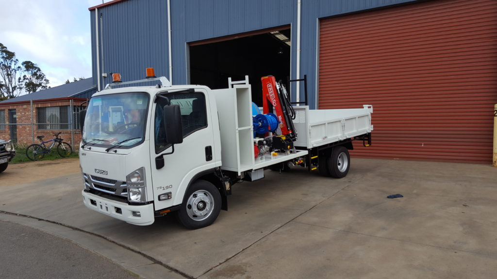 service vehicle with a tipping tray. Small crane with a water supply and pump system.