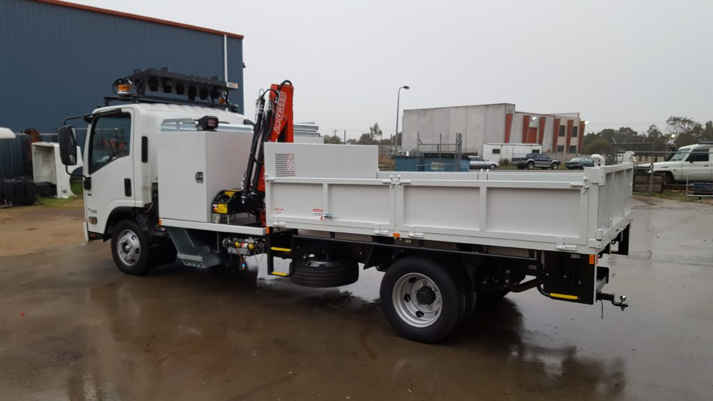 Service vehicle with tipping tray. Small crane with toolbox storage